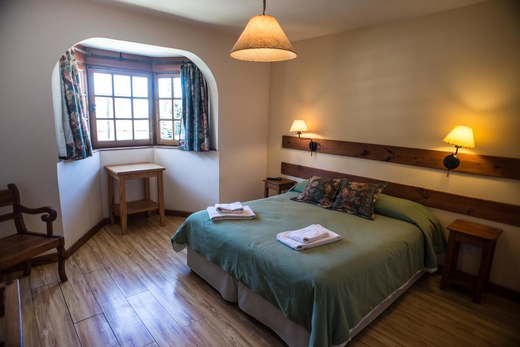 Quarto triplo do Las Marianas Hotel em Bariloche